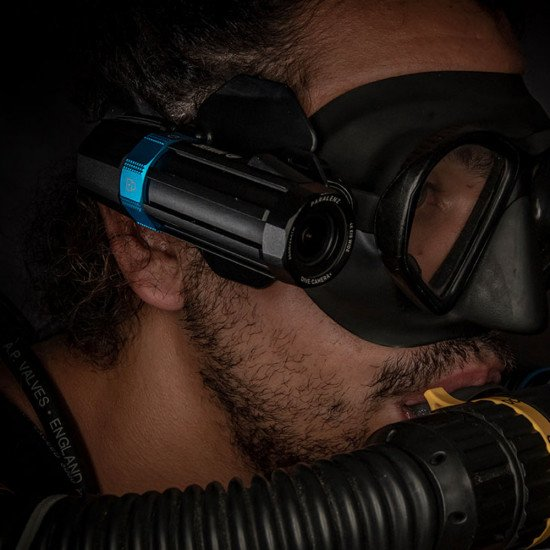 Paralenz Adjustable Mask Mount attached to a mask preparing for a dive